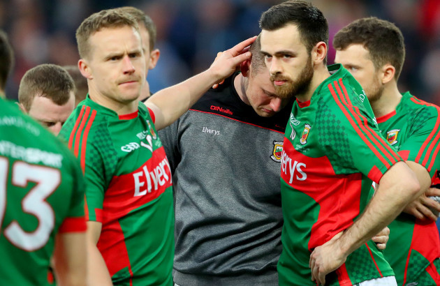 robert-hennelly-consoled-by-andy-moran-and-kevin-mcloughlin-after-the-game