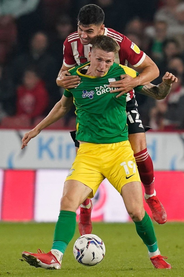 sheffield-england-14th-september-2021-john-egan-of-sheffield-utd-and-emil-riis-jakobsen-of-preston-north-end-during-the-sky-bet-championship-match-at-bramall-lane-sheffield-picture-credit-should