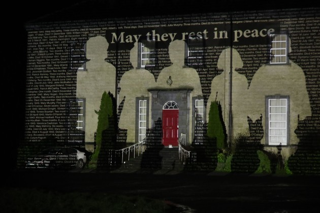 an-image-of-silhouettes-of-children-and-the-names-of-children-who-died-in-bessborough-mother-and-baby-home-in-cork-are-projected-onto-sean-ross-abbey-south-of-roscrea-in-county-tipperary-ireland-on