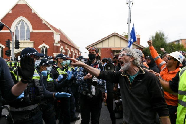 melbourne-australia-18-september-2021-protesters-shout-at-police-during-the-freedom-protest-on-september-18-2021-in-melbourne-australia-freedom-protests-are-part-of-an-international-co-ordinate
