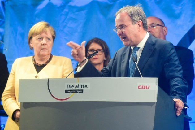 christian-democratic-union-cdu-leader-and-top-candidate-for-chancellor-armin-laschet-speaks-next-to-german-chancellor-angela-merkel-during-his-election-rally-in-stralsund-germany-september-21-2021