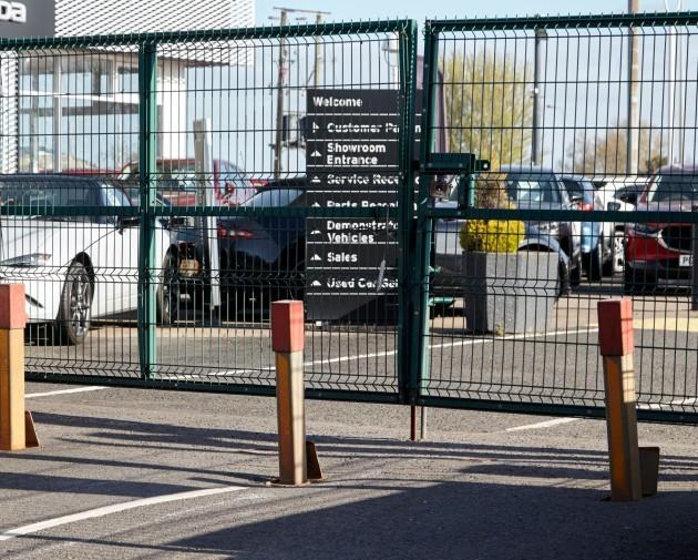security-bollards-and-closed-gates-at-car-dealership-due-to-coronavirus-lockdown-newtownabbey-northern-ireland-uk