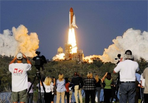 NASA launches Discovery shuttle for final space mission ...